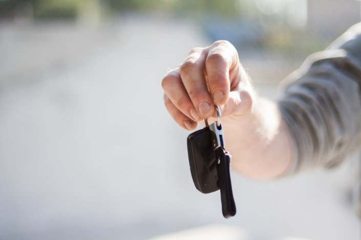 a person holding a car key